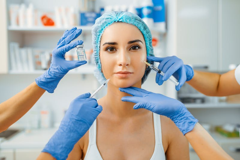 cosmetician with botox and female patient